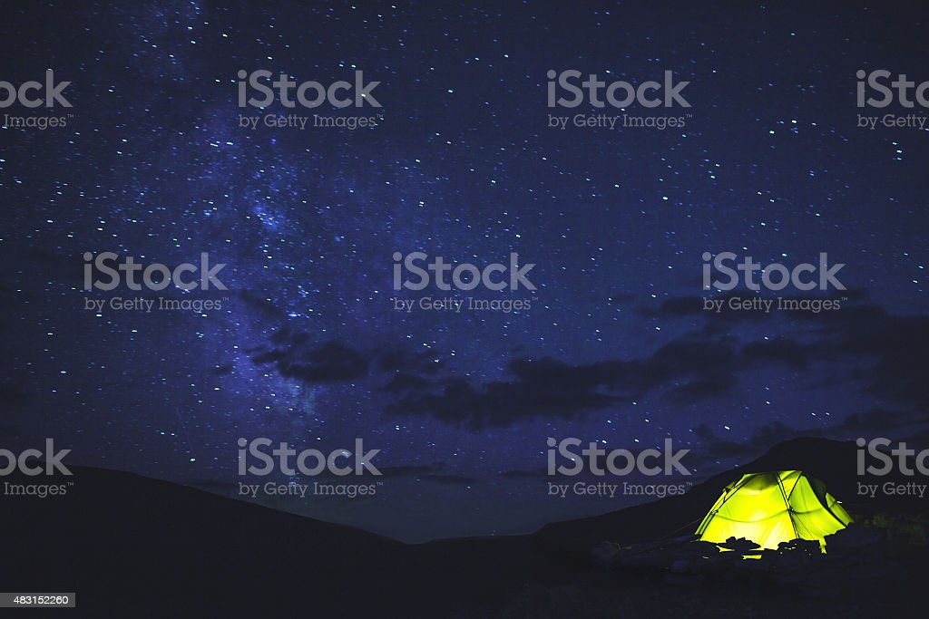 Tent under the starry sky stock photo