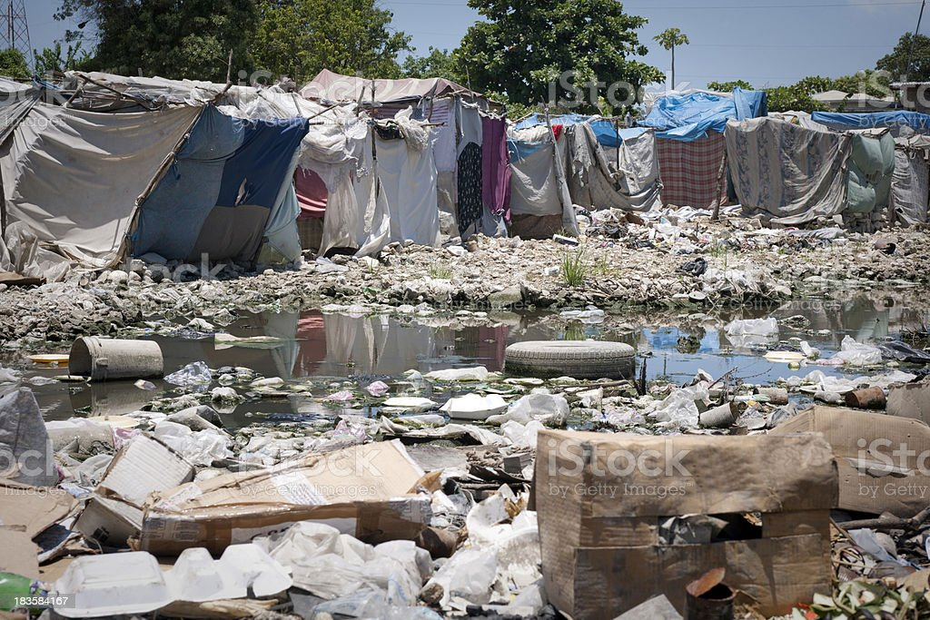 Tents and garbage in a refugee camp royalty-free stock photo