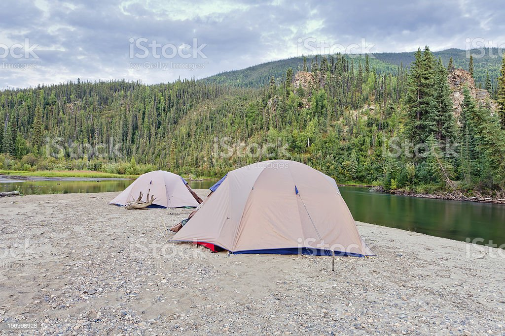 Tents at river in remote Yukon taiga wilderness royalty-free stock photo