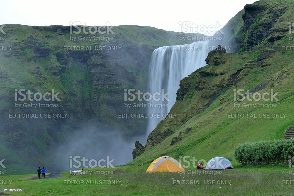 Tents by Skogafoss in Iceland stock photo