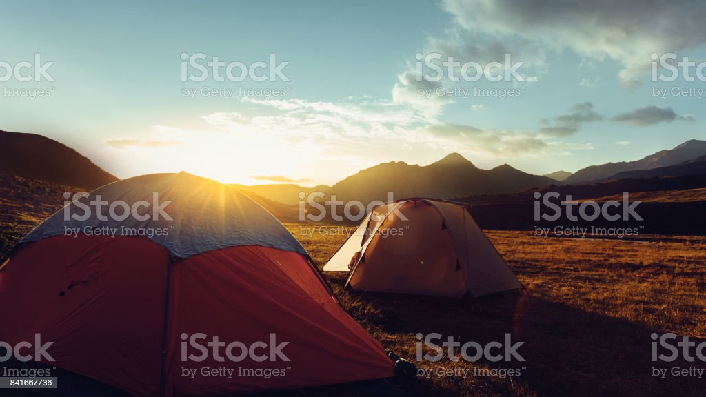 Tents During Beautiful Sunrise Near The Mount Elbrus In Russia stock photo
