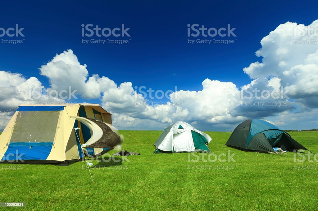 Tents in a green field royalty-free stock photo