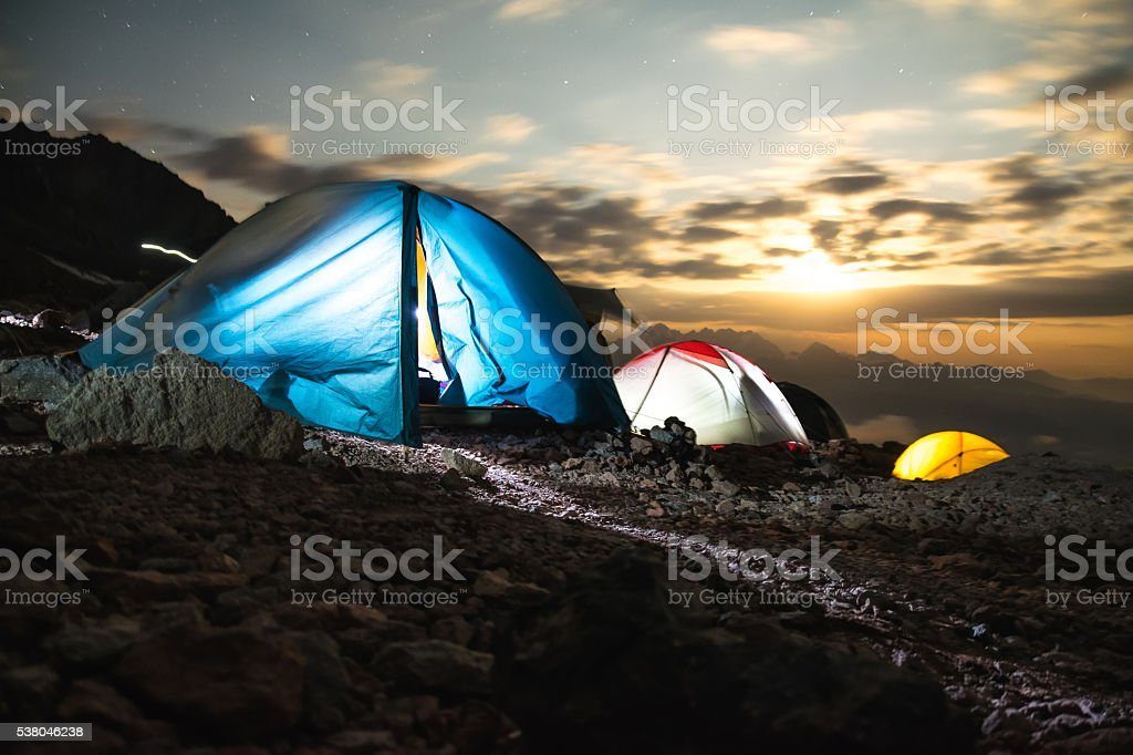 Tents in the mountains at night stock photo