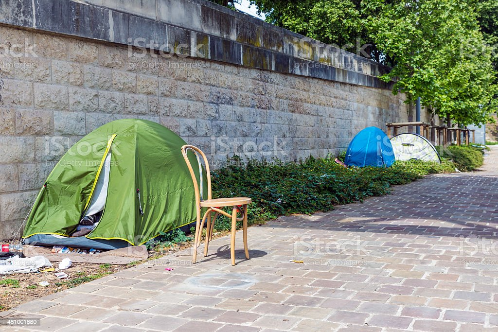 Tents of homeless people at riverside Seine in Paris stock photo