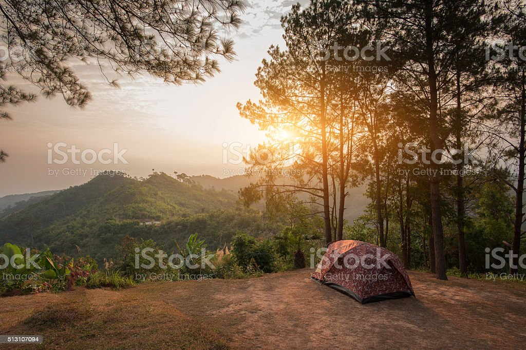 Tents on a hills at sunrise at Taksin Maharach stock photo
