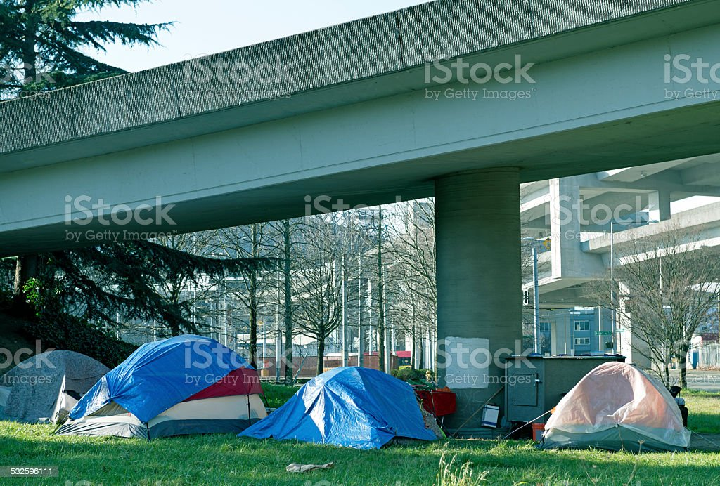 Tents under freeway onramp south of downtown Seattle WA stock photo