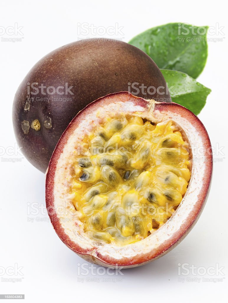 Teo passion fruit one cut in half on a white background stock photo