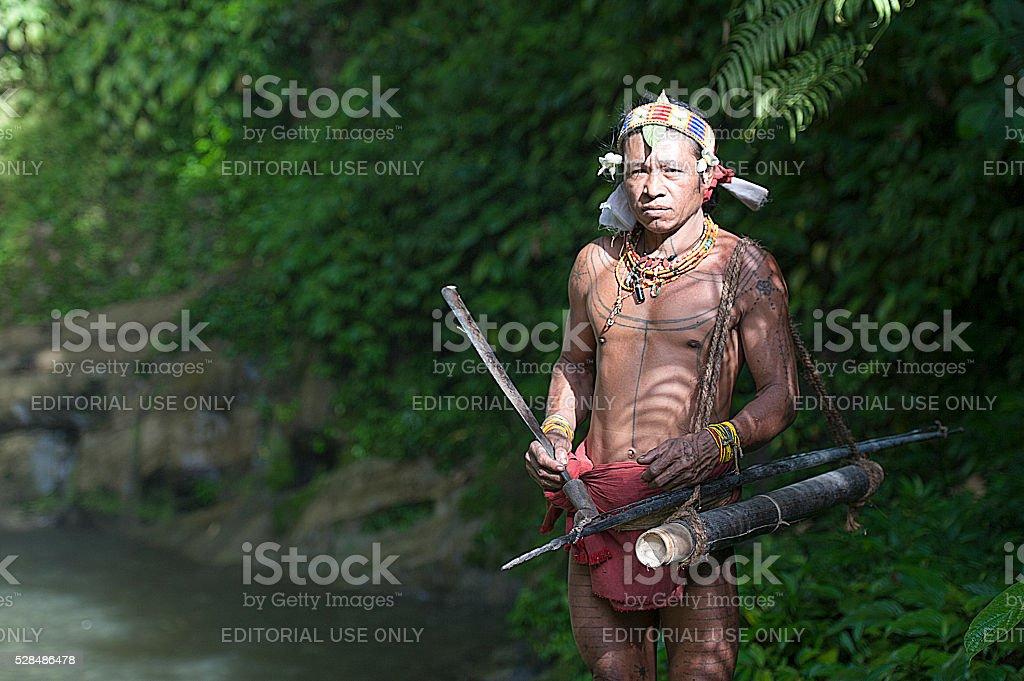 Teo Tak Gogo, 55, the Mentawai tribe pose for camera. stock photo