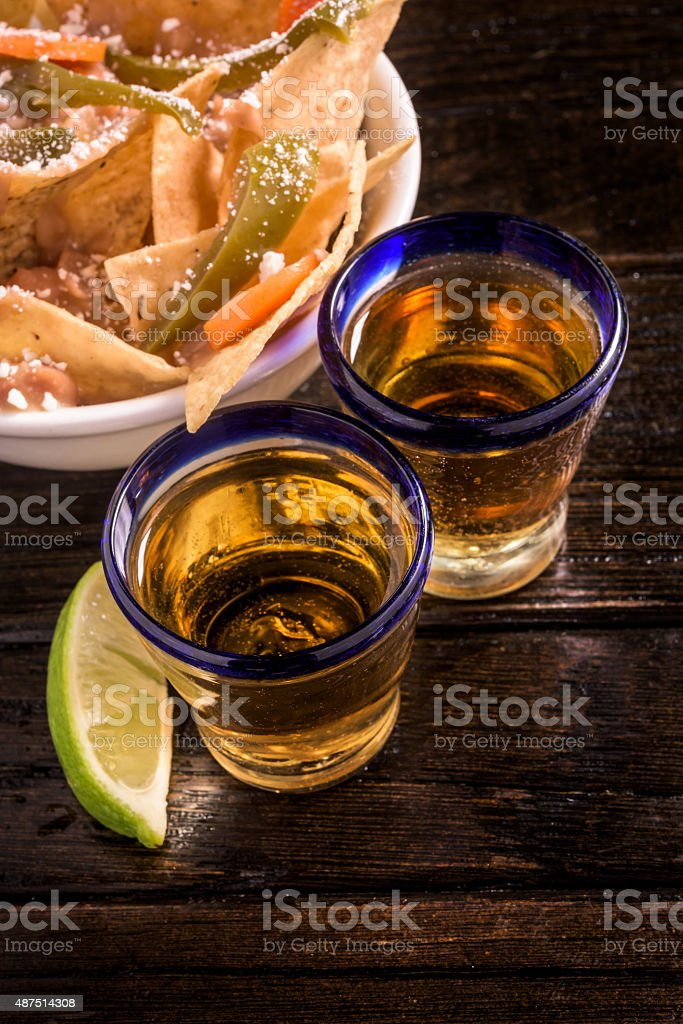 Tequila and tortilla chips stock photo
