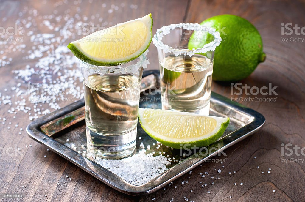 Tequila gold, Mexican, alcohol in shot glasses stock photo