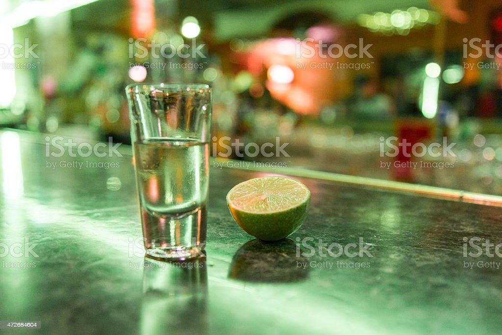 Tequila in a shot glass stock photo