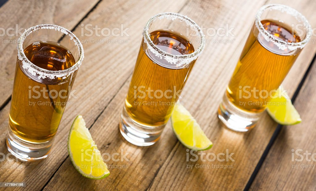 Tequila in shot glasses with lime and salt stock photo