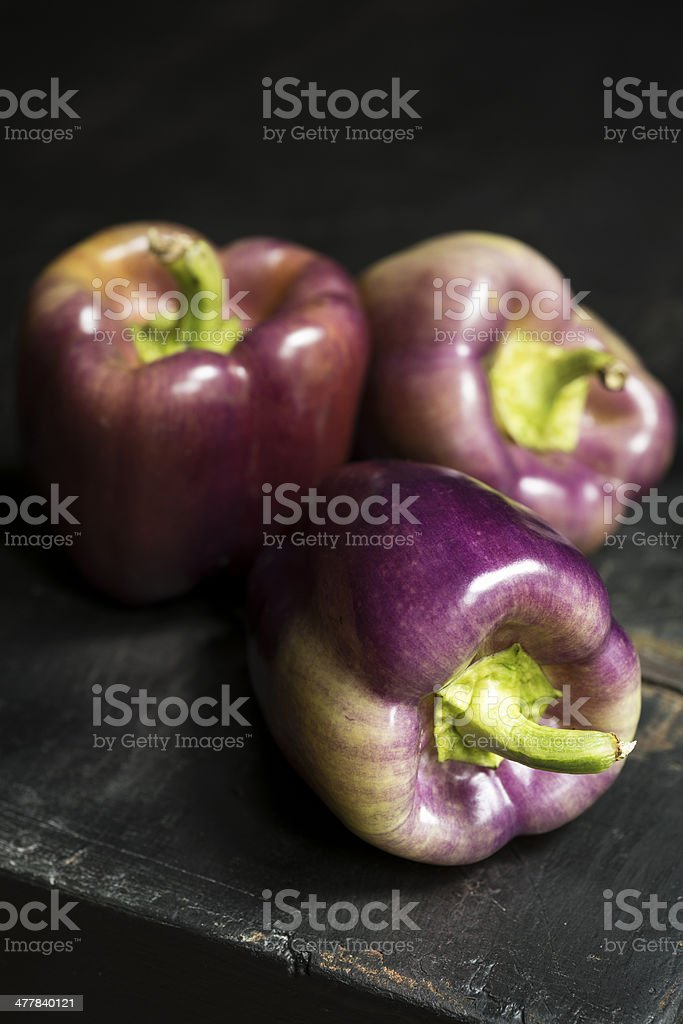 Tequila Peppers on Black Rustic Surface with Copy Space stock photo