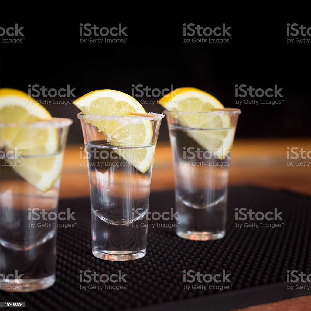 Tequila shot with lemon stock photo