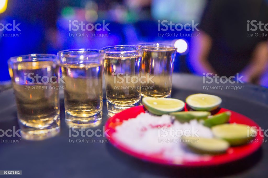 Tequila shots in a row stock photo