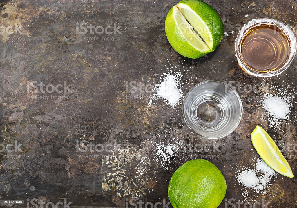 Tequila shots with lime slice, top view stock photo