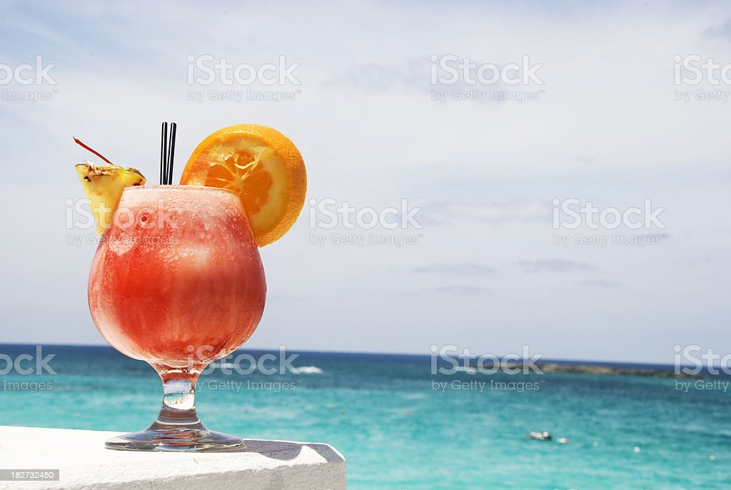 Tequila sunrise cocktail on a table in the Caribbean  stock photo