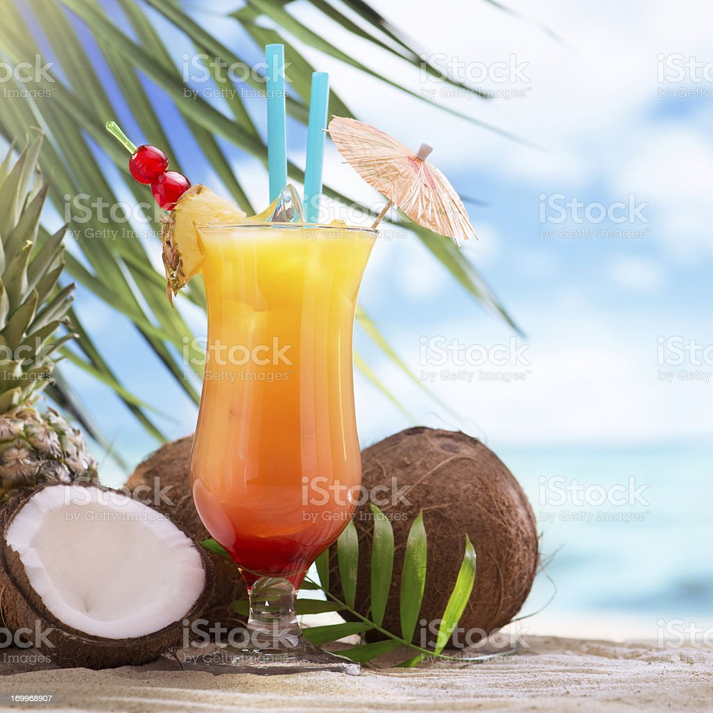 Tequila sunrise cocktail on the beach stock photo