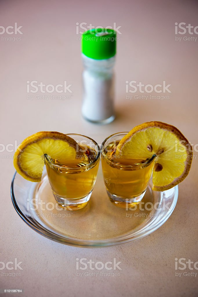 tequila-two glasses of tequila, salt and lime stock photo