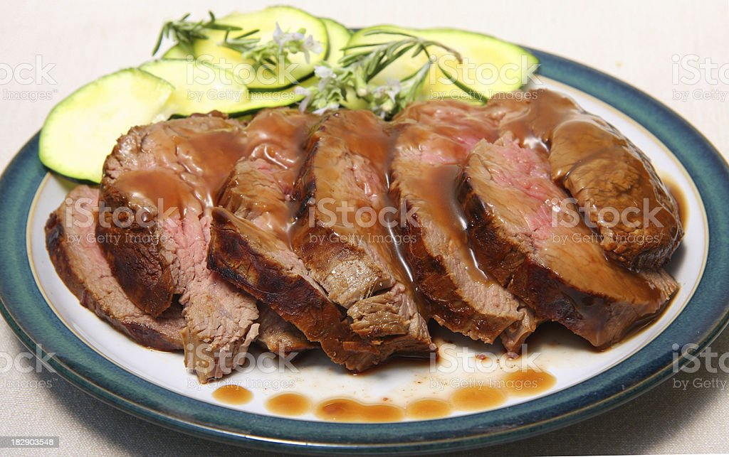 Teriyaki Beef with zucchini and rosmarin flowers royalty-free stock photo