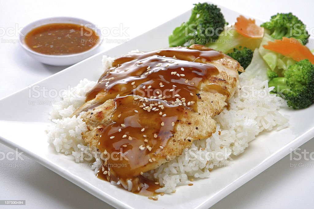 Teriyaki Chicken over Steam Rice stock photo
