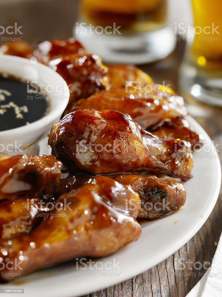 Teriyaki Chicken Wings and Beer stock photo
