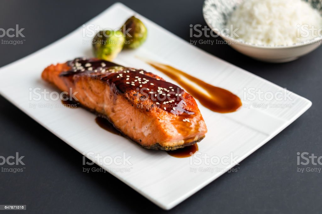 Teriyaki salmon on black background. stock photo
