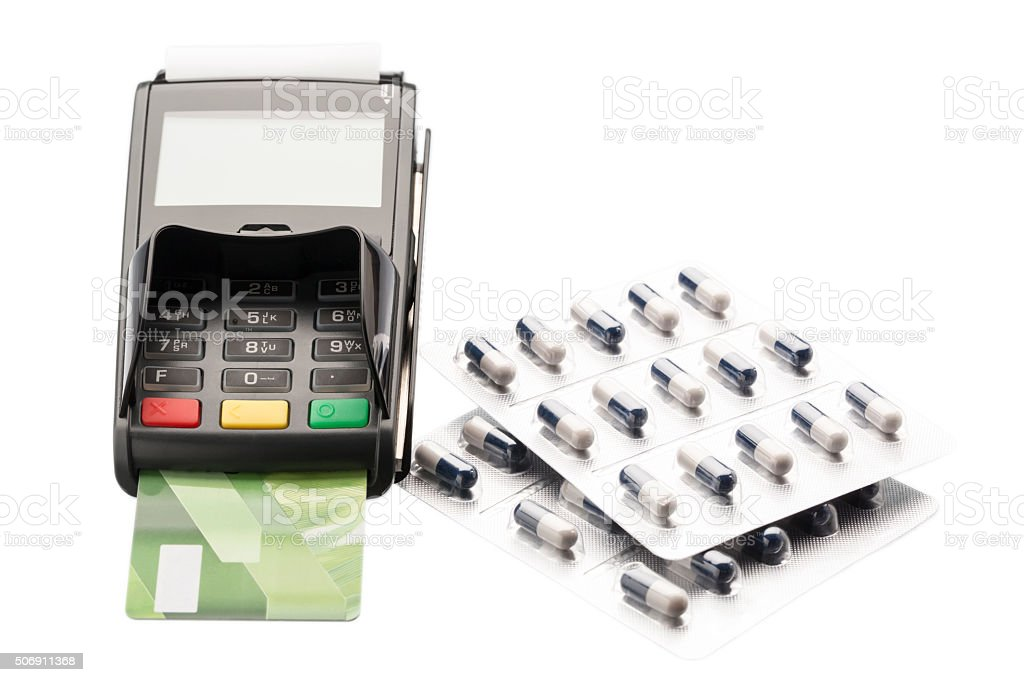POS terminal, credit card and pill blister packs stock photo