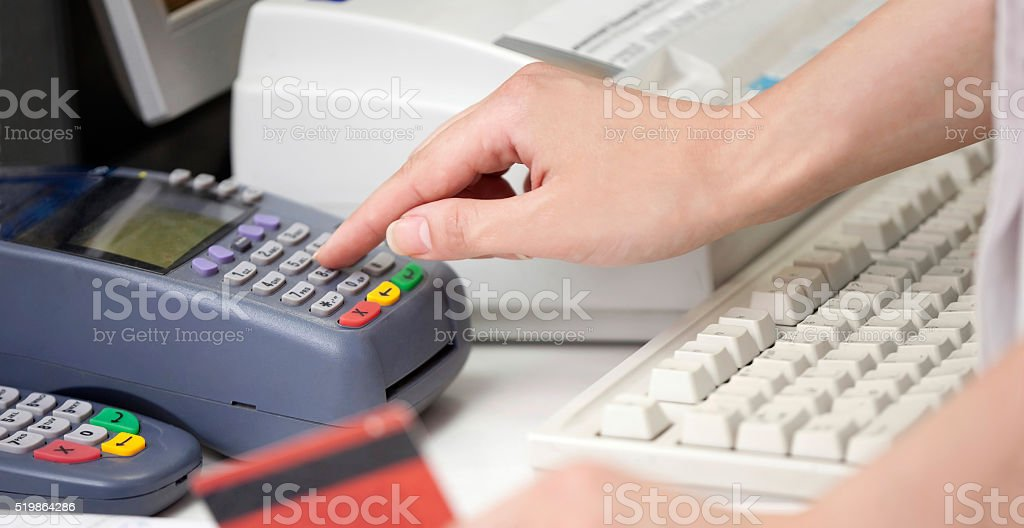 POS Terminal Transaction. Hand Swiping a Credit Card. stock photo