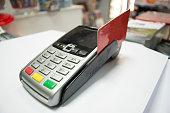 POS Terminal with a credit card.