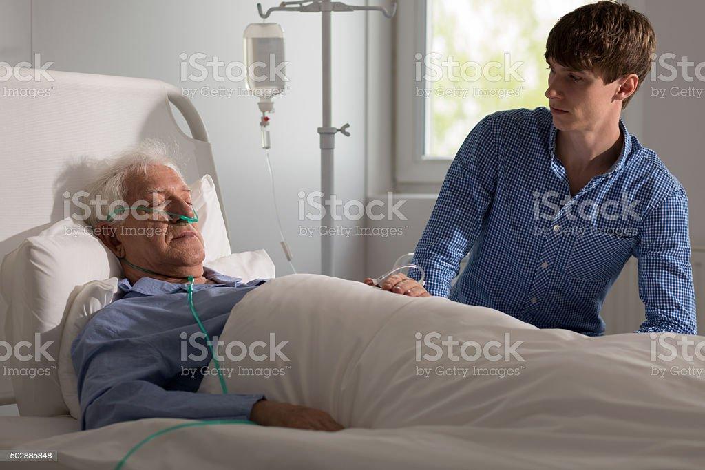 Terminally ill man stock photo