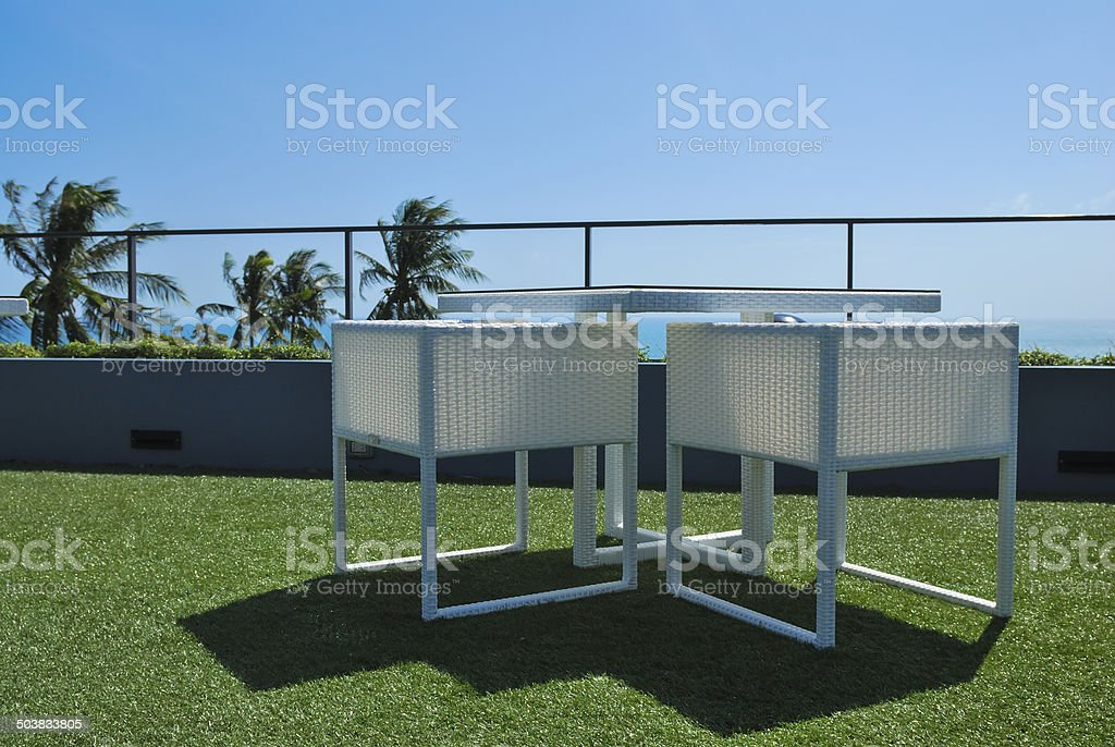 Terrace lounge with white rattan armchairs  in a luxury resort stock photo