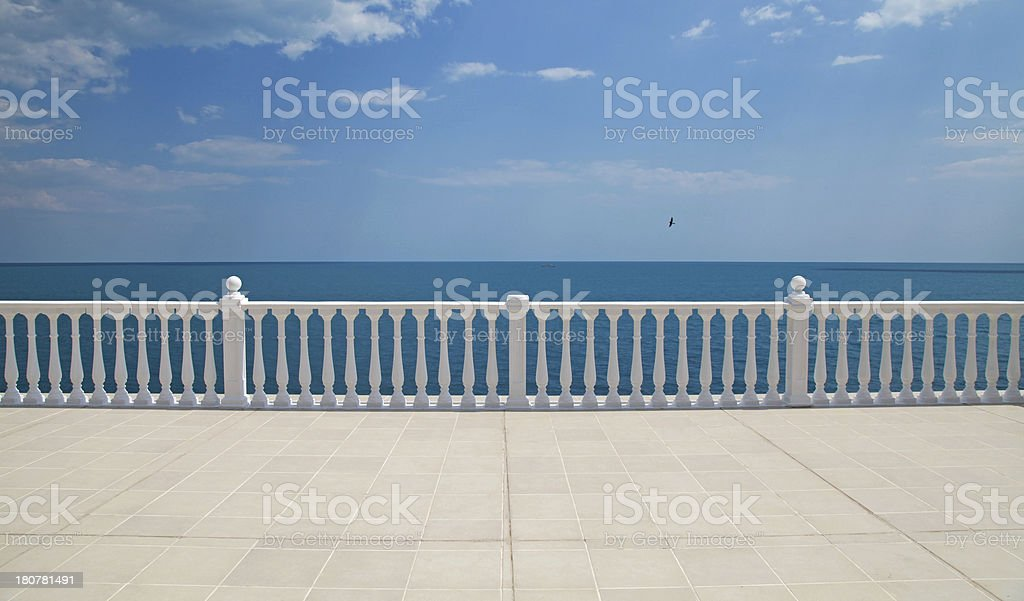 terrace with balustrade overlooking the sea stock photo