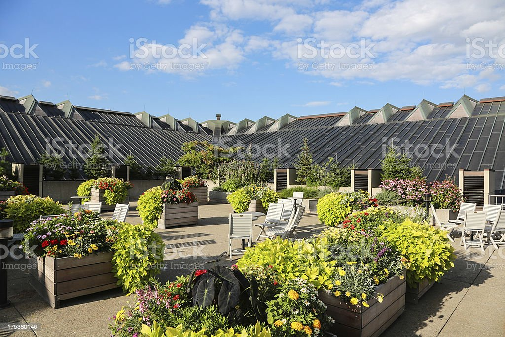 Terrace with Chairs and Flowers on Roof Building stock photo