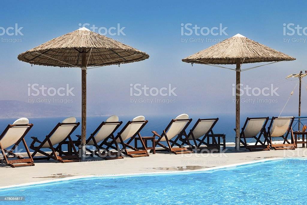 Terrace with chairs and swimming pool royalty-free stock photo