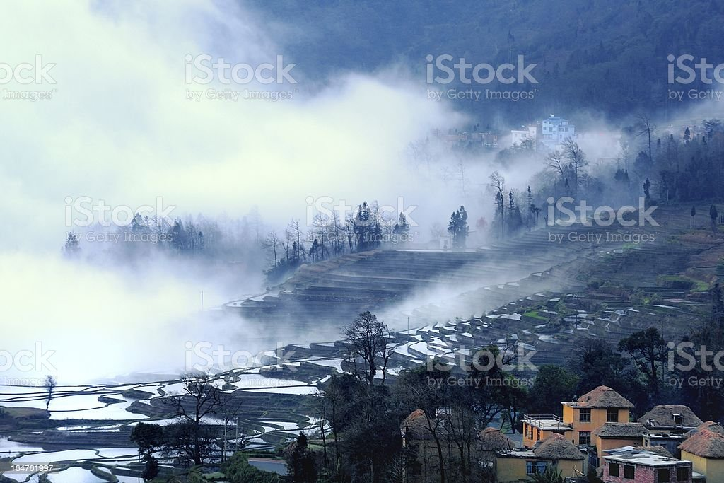 Terraced fields and villages in the clouds royalty-free stock photo