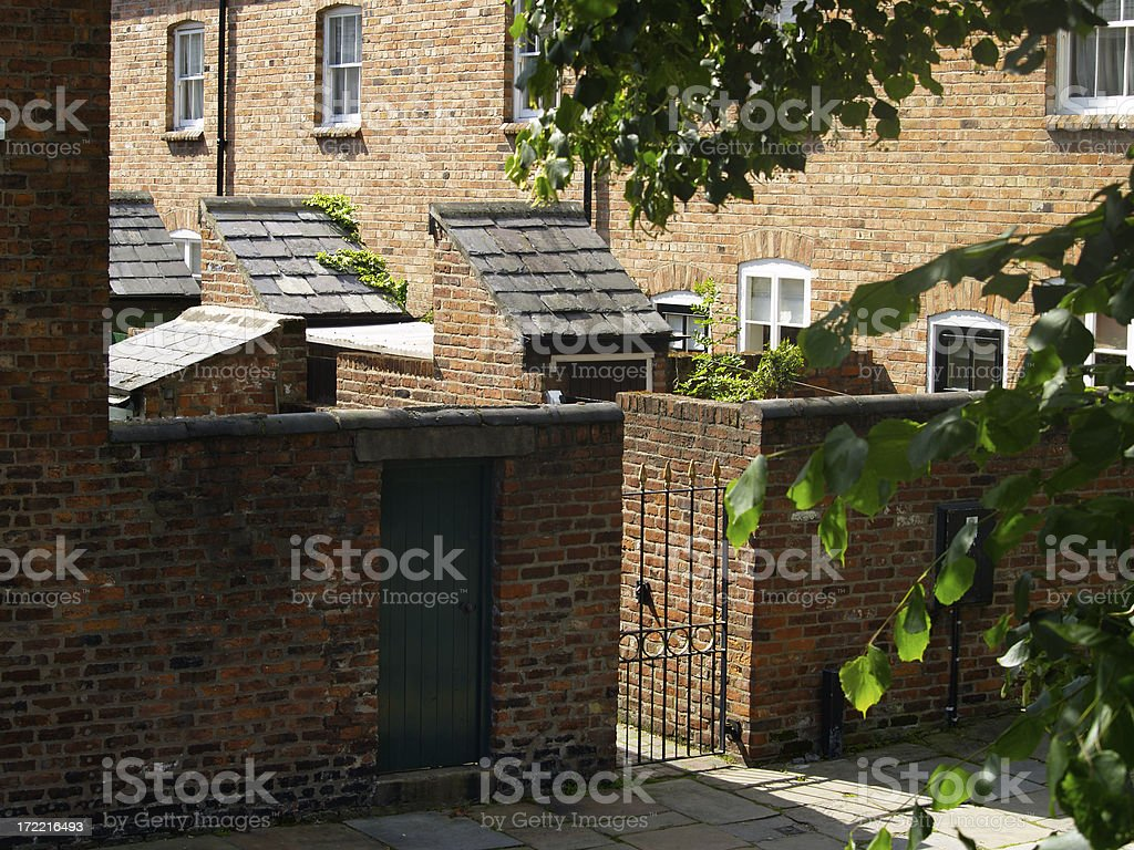 Terraced houses with outside toilet outbuilding stock photo