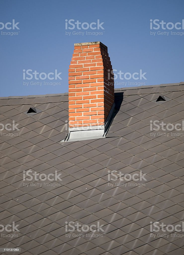 Terracotta chimney on the metal roof royalty-free stock photo