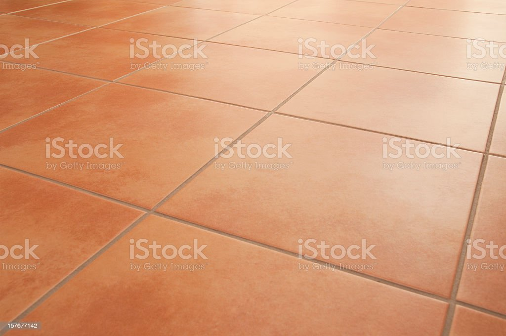 Terracotta floor tiles clean background diminishing perspective stock photo