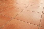 Terracotta floor tiles clean background diminishing perspective