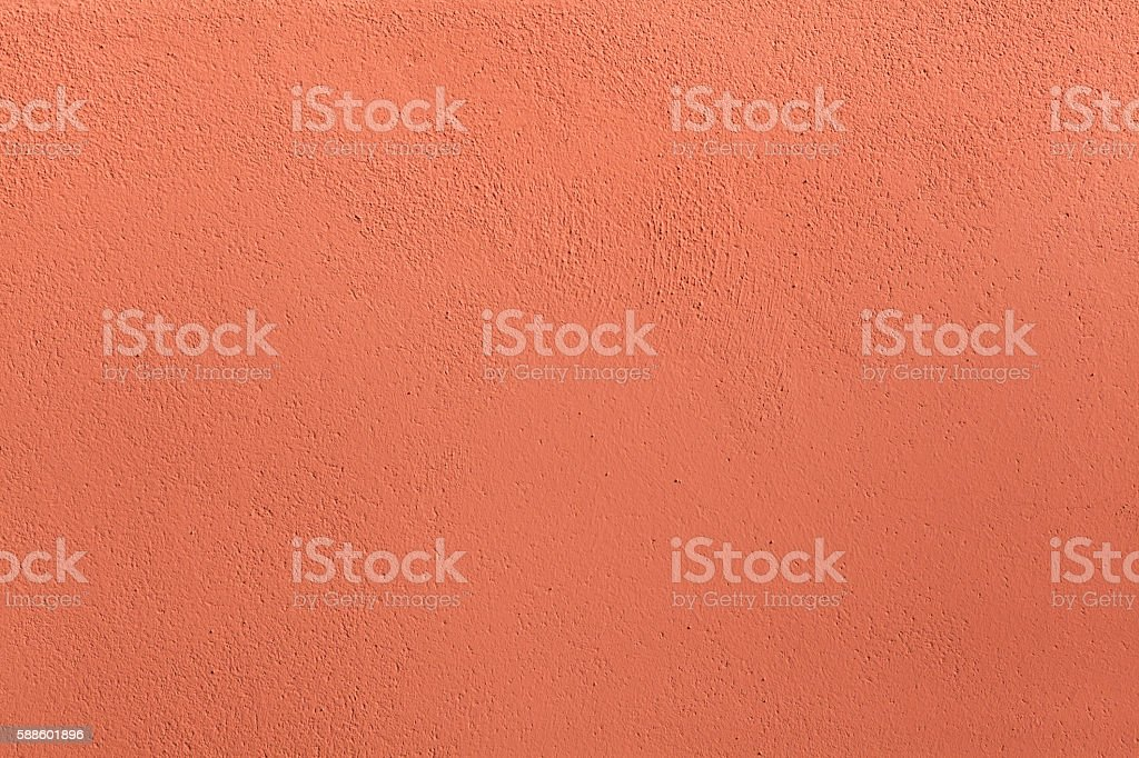 Terracotta painted stucco wall. Background texture stock photo
