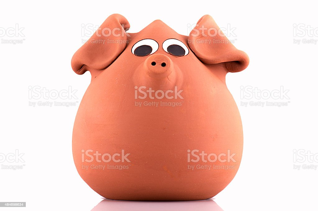 terracotta piggy bank, isolated on white background stock photo