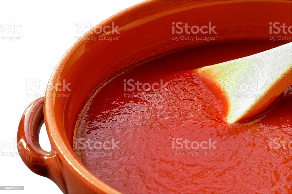 Terracotta pot  with tomato sauce. W/ clipping path stock photo