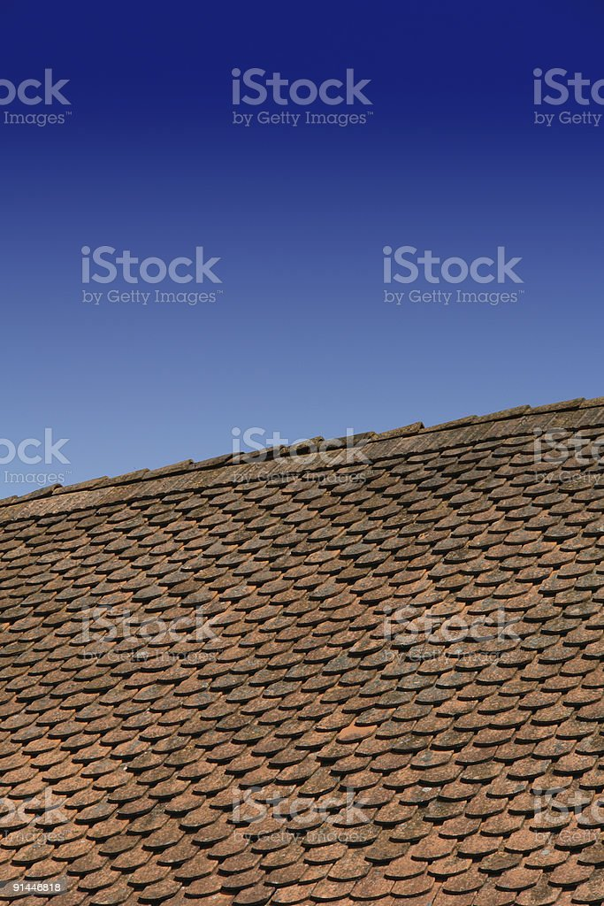 Terracotta roof and blue sky stock photo