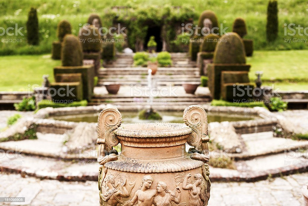 Terracotta urn with topiary garden royalty-free stock photo