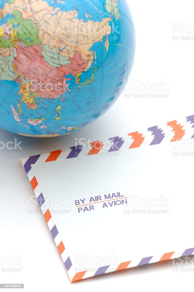Terrestrial globe and envelopes for air mail stock photo