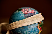 terrestrial globe with a piece of cloth tied around it