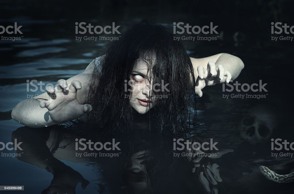 Terrible dead ghost woman in the water stock photo
