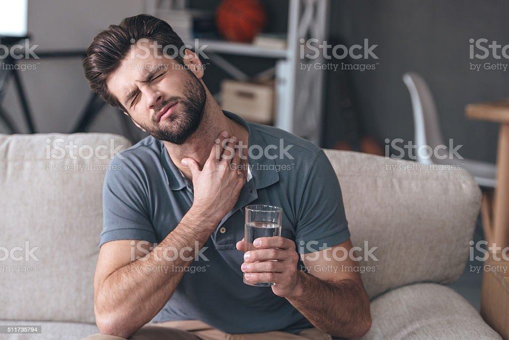 Terrible pain in his throat. stock photo