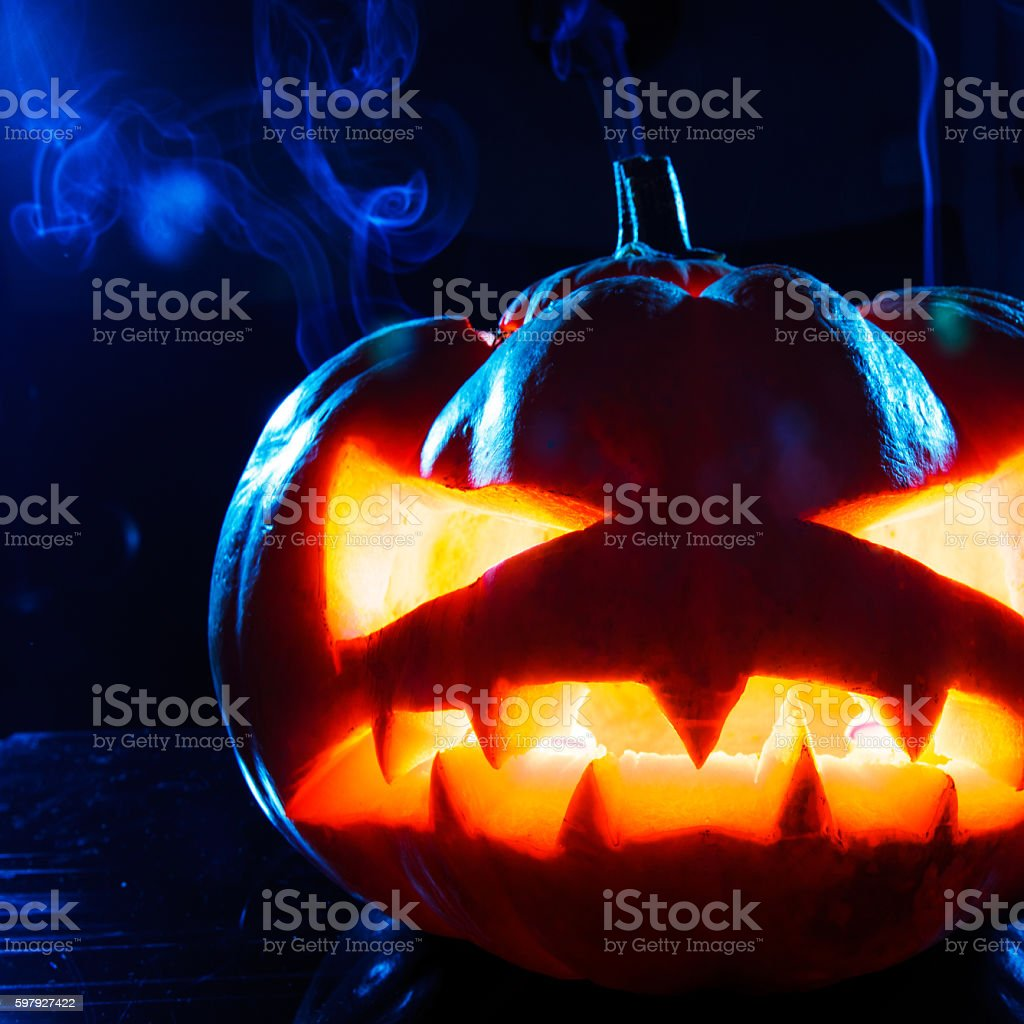 terrible pumpkin on black background stock photo
